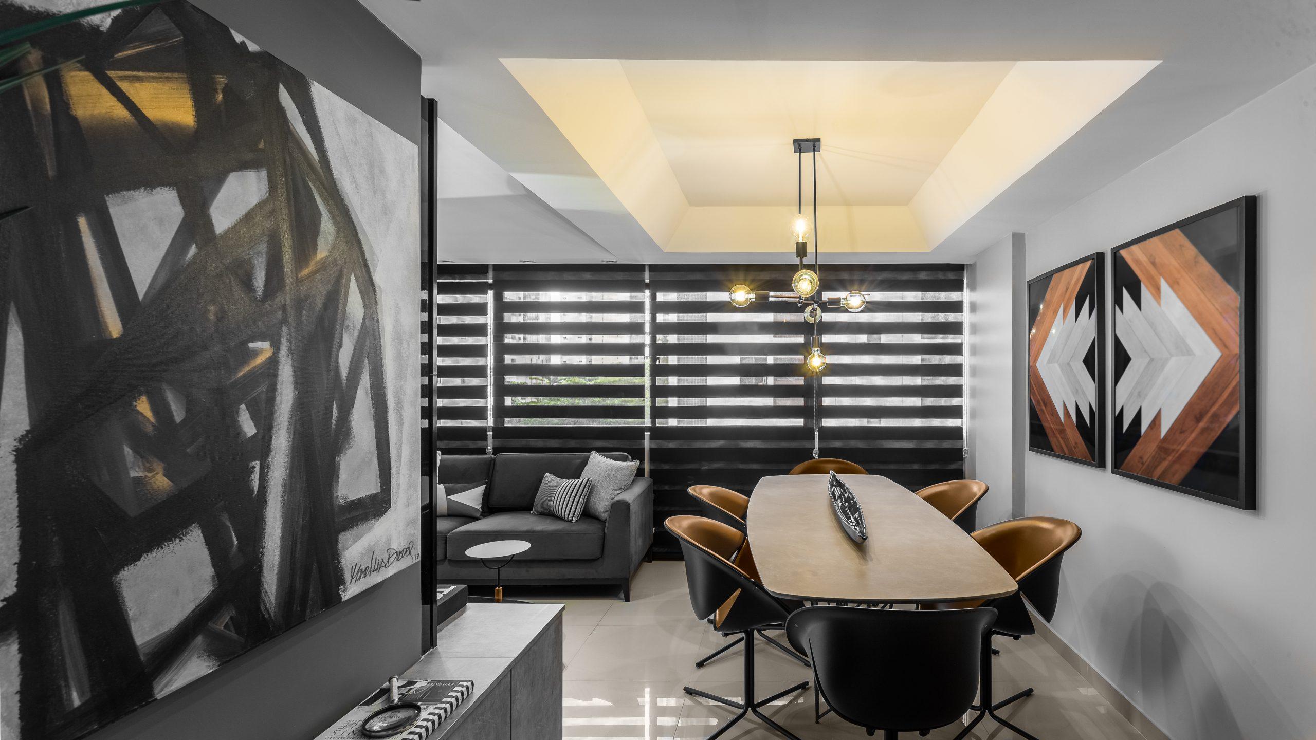 Sala de estar preto e cimento com obras de arte